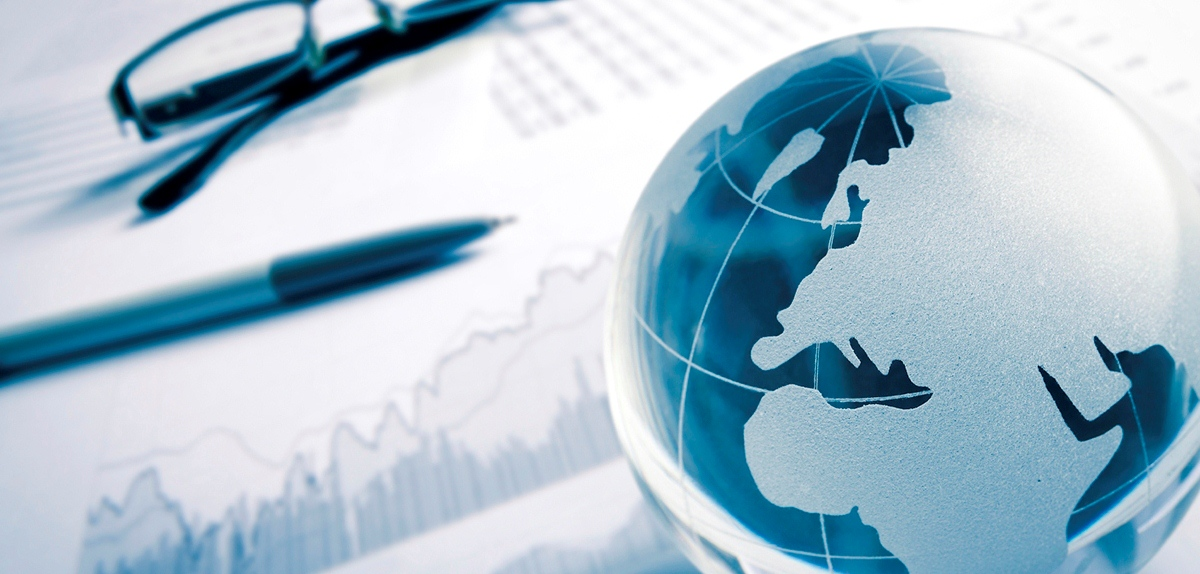 glass globe with stock charts